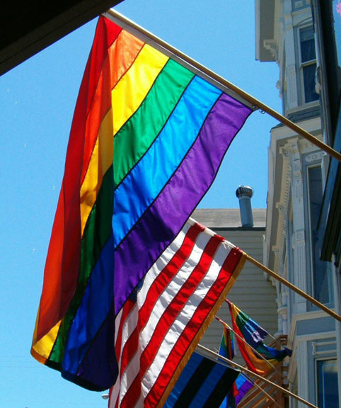 Rainbow flag next to US Flag
