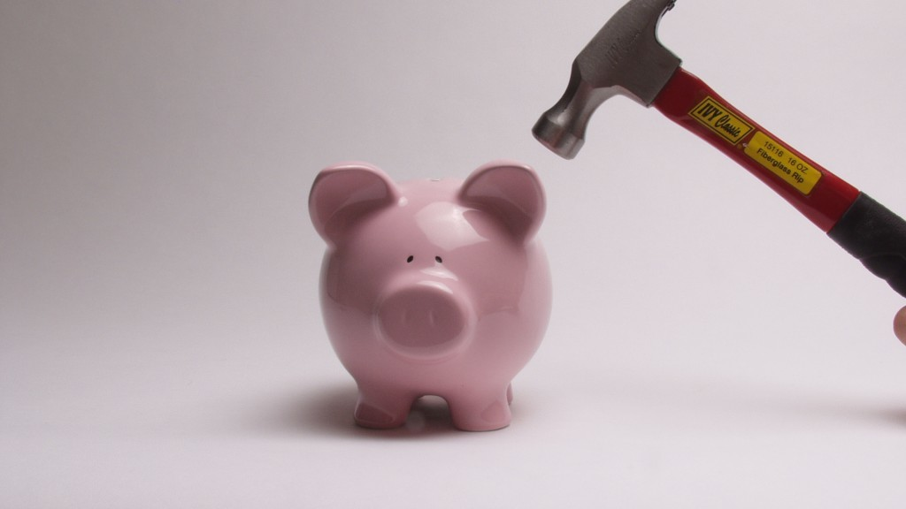 Piggy Bank with Hammer hovering above