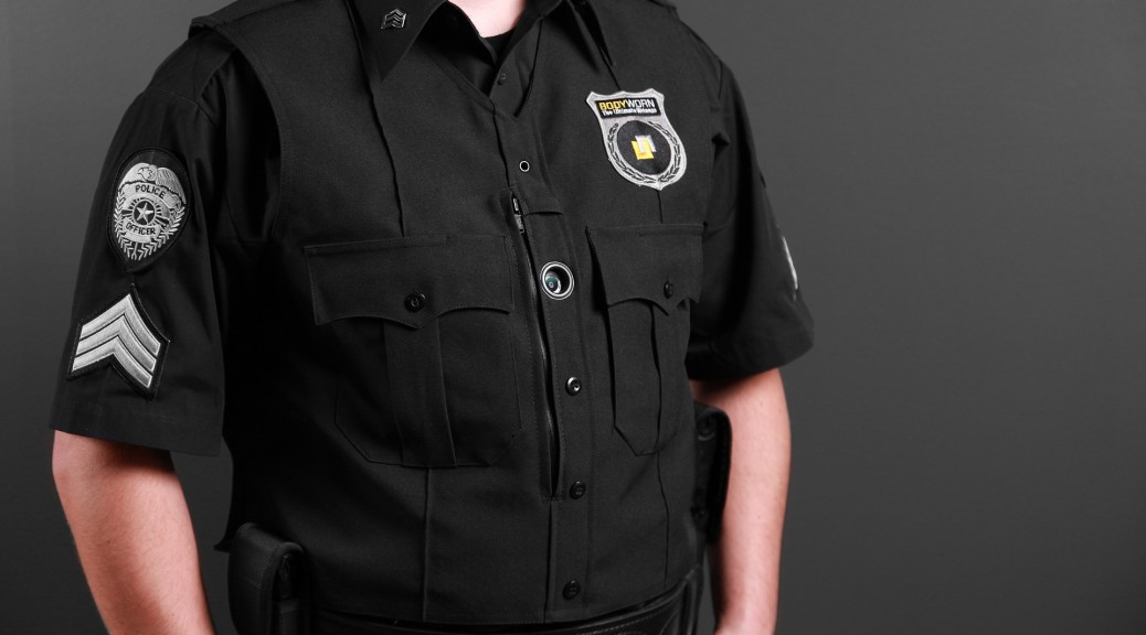 Police officer in uniform with a visible body camera showing