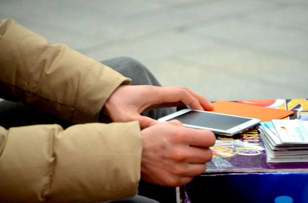 Man protecting his cell phone - text messages can be used against you in divorce court